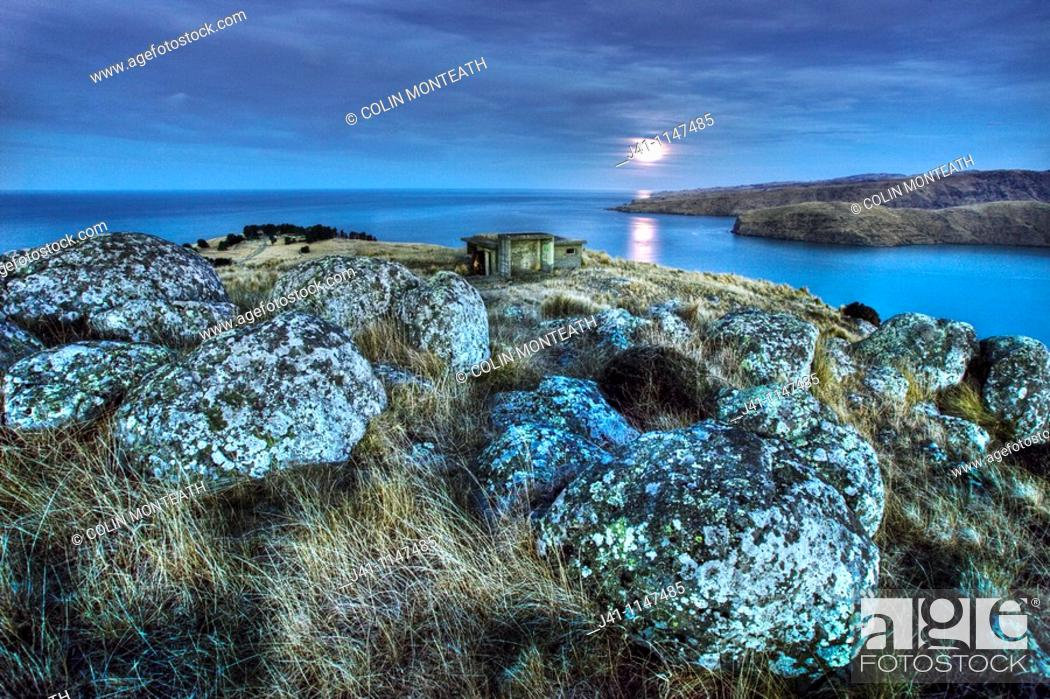Stock Photo: Moonlight over Godley Head near entrance to Lyttelton harbour, WWII gun emplacements in trees below and old observation post in foreground, Christchurch.