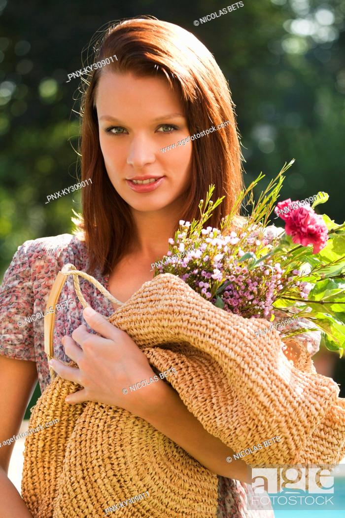 Stock Photo: Young woman holding bouquet.