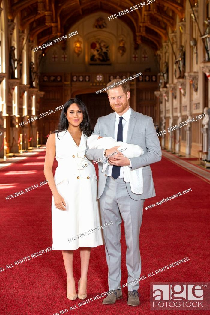 Stock Photo: The Duke and Duchess of Sussex with their baby son, who was born on Monday morning, during a photocall in St George's Hall at Windsor Castle in Berkshire.