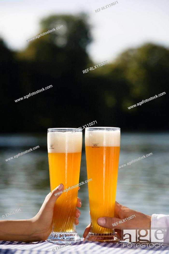 Stock Photo: Close-up of young couple drinking beer in Seehaus, beer garden, Munich, Germany.