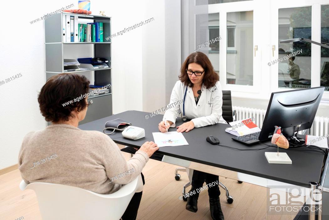 Stock Photo: Doctor consulting senior female patient.