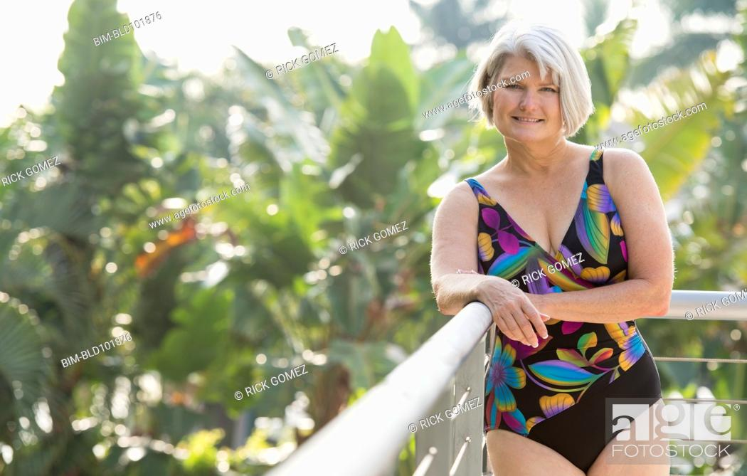 Stock Photo: Caucasian woman standing in bathing suit.