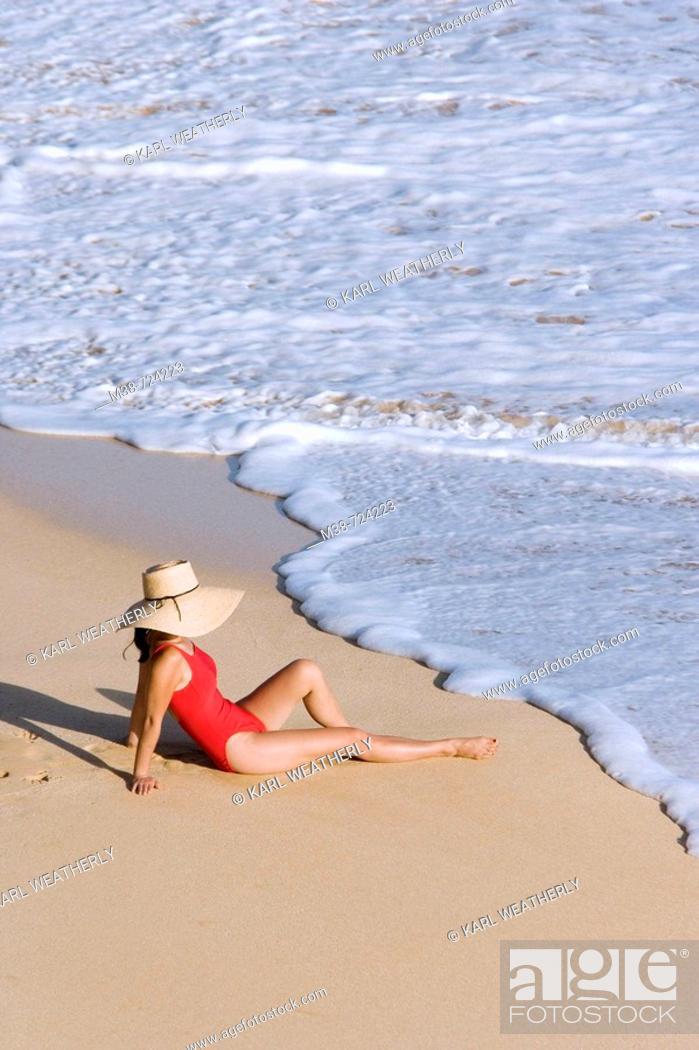 Stock Photo: Woman sitting on beach, Maui, Hawaii, USA.