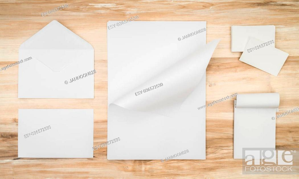 Stock Photo: Blank envelopes ,Name card and White template paper on wooden background.