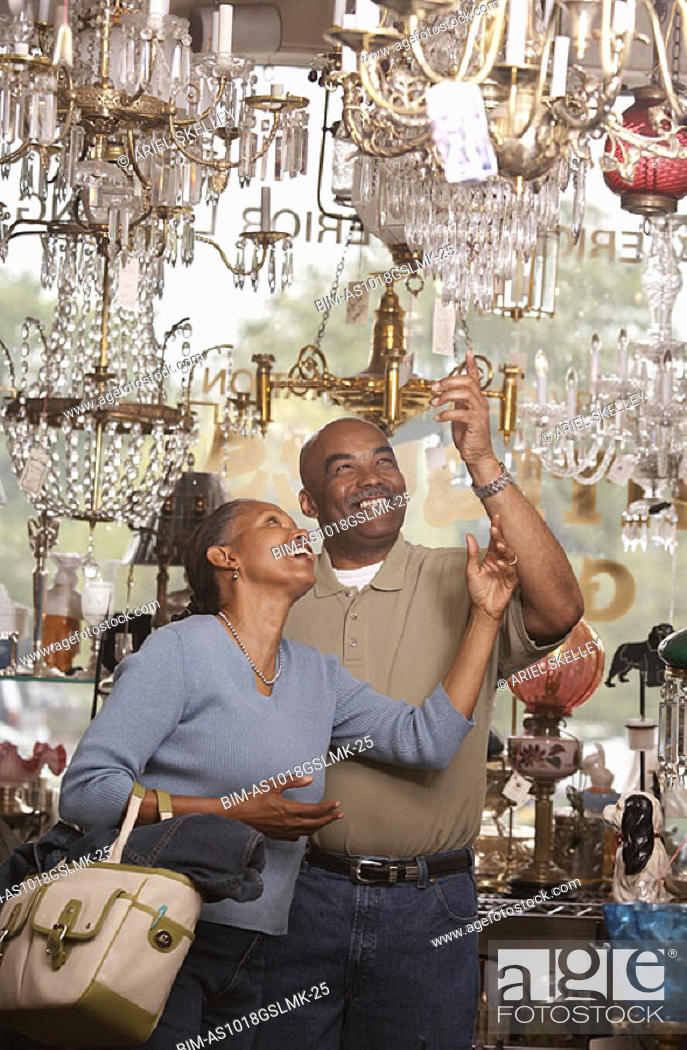 Stock Photo: Couple shopping in antique store.
