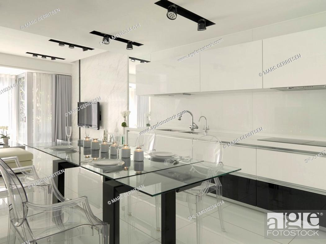 Stock Photo: Large glass dining table in kitchen.