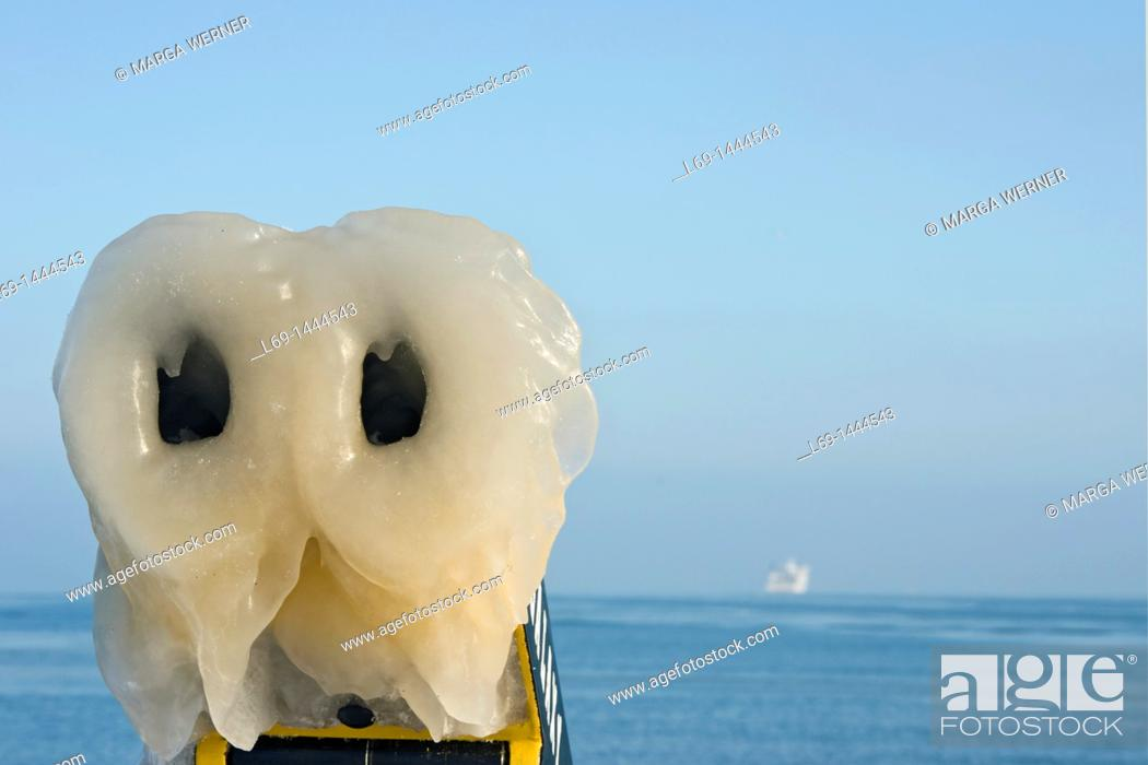 Stock Photo: Icy Binoculars, Baltic Sea ferry in the background, sight from the ', Nordermole', the seaside resort of Travemünde near Lübeck in Winter, Germany, Europe.
