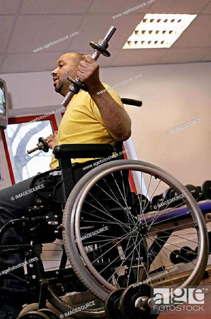 Stock Photo: Disabled man lifting weights.