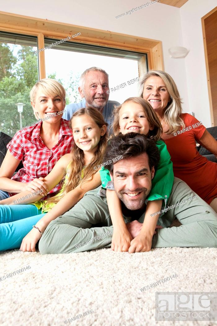 Stock Photo: Germany, Bavaria, Nuremberg, Portrait of family in living room.
