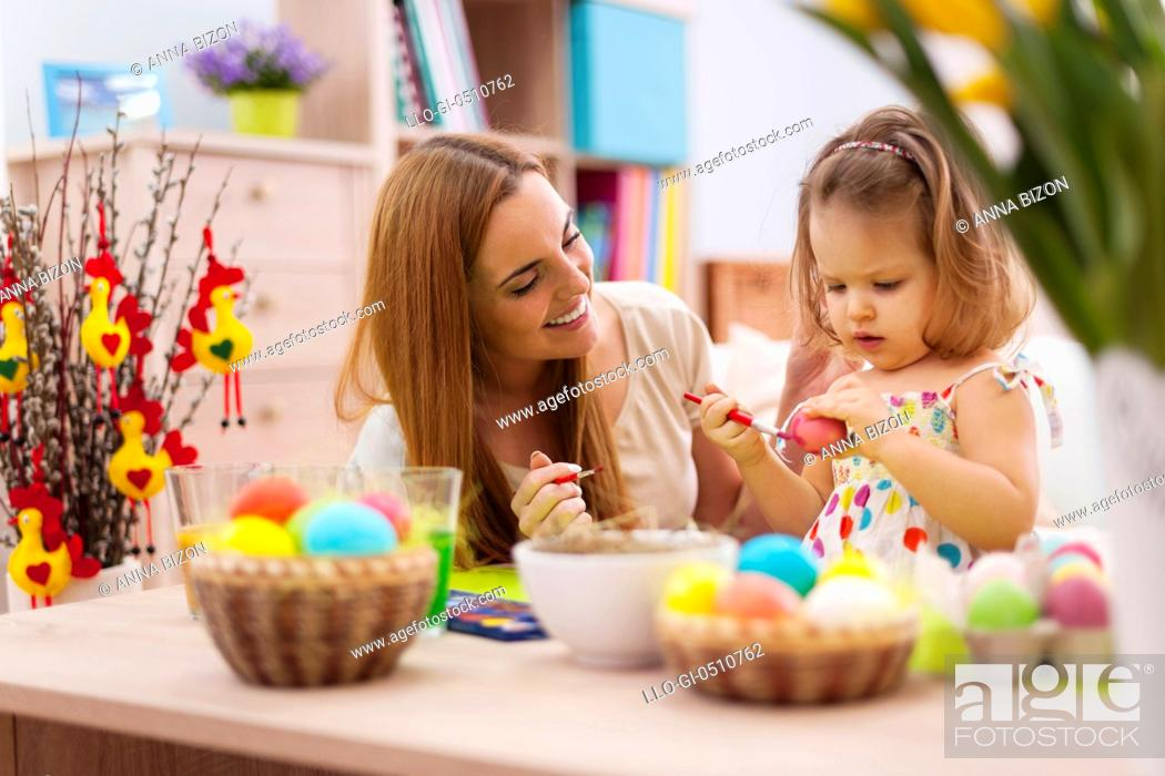 Stock Photo: Mother and baby painting easter eggs. Debica, Poland.
