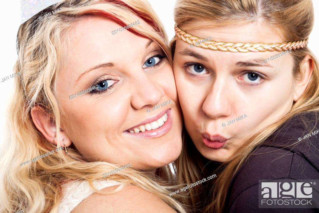 Imagen: Closeup of two young blond happy girlfriends.