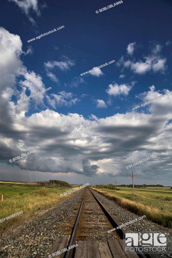 Stock Photo: Storm Clouds Saskatchewan Prairie scene Train Tracks.