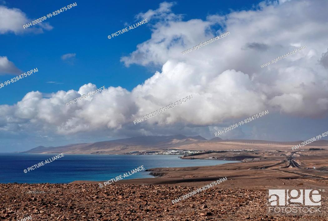 Stock Photo: 06 December 2019, Spain, Pajara: Panoramic view in south direction over the beach of the Atlantic Coast at the Costa Calma.
