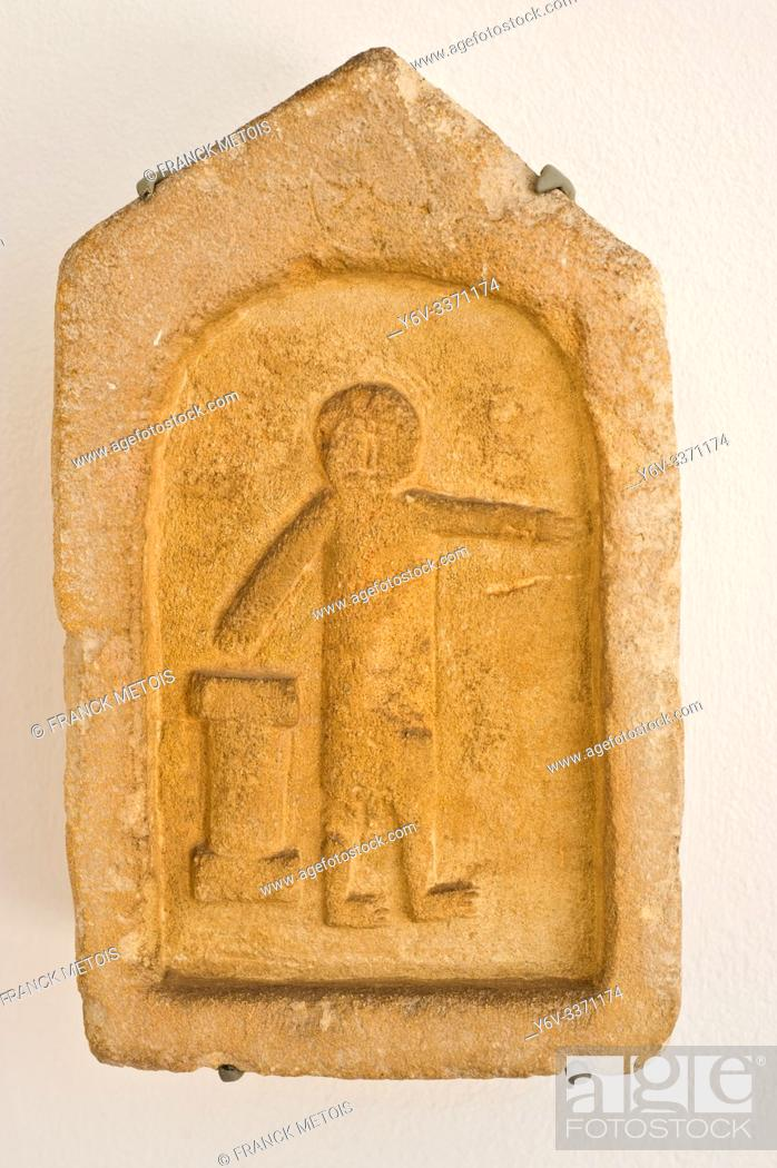 Stock Photo: Votive stele from the ancient town of Volubilis ( Museum of history and civilisations in Rabat, Morocco). It is probably dating from the 1° century BC.