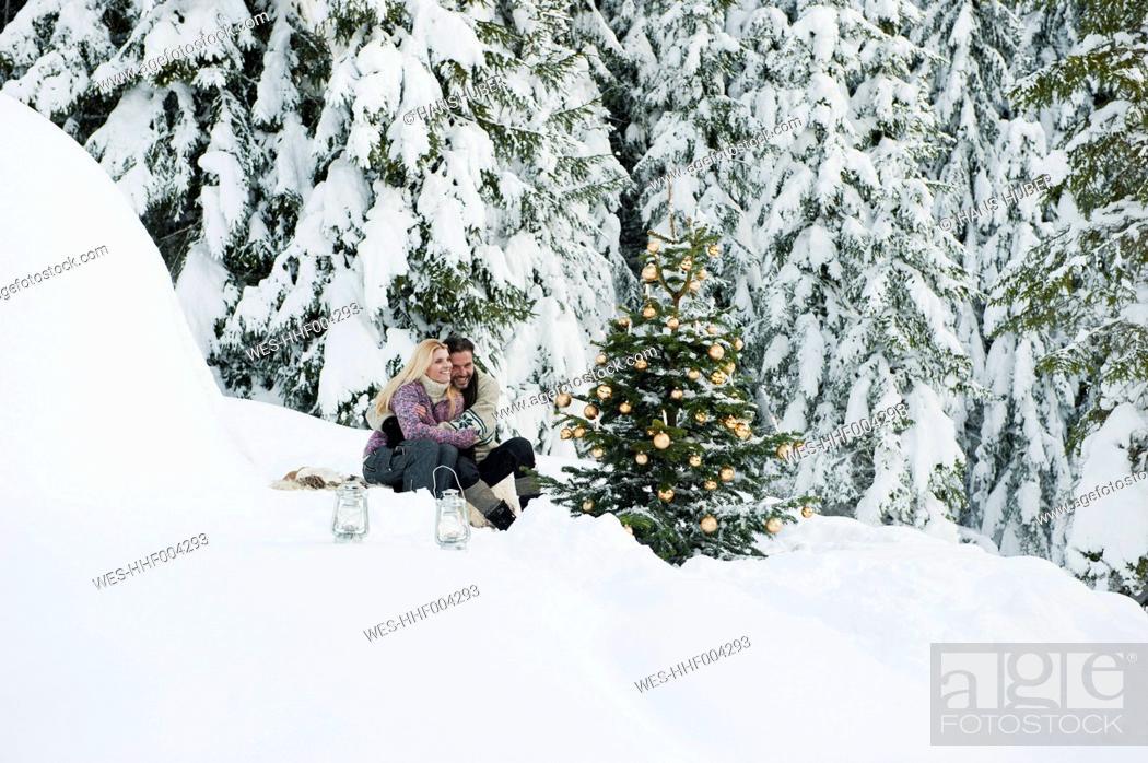 Stock Photo: Austria, Salzburg County, Couple celebrating christmas in snowy landscape.