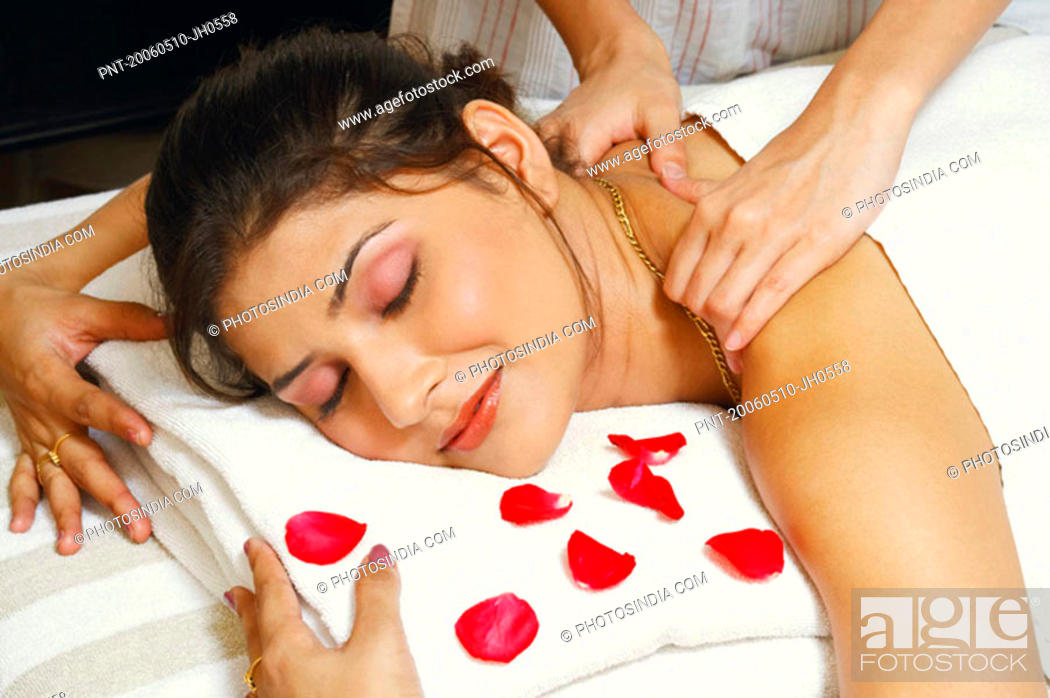 Stock Photo: Close-up of a young woman getting a shoulder massage from a massage therapist.