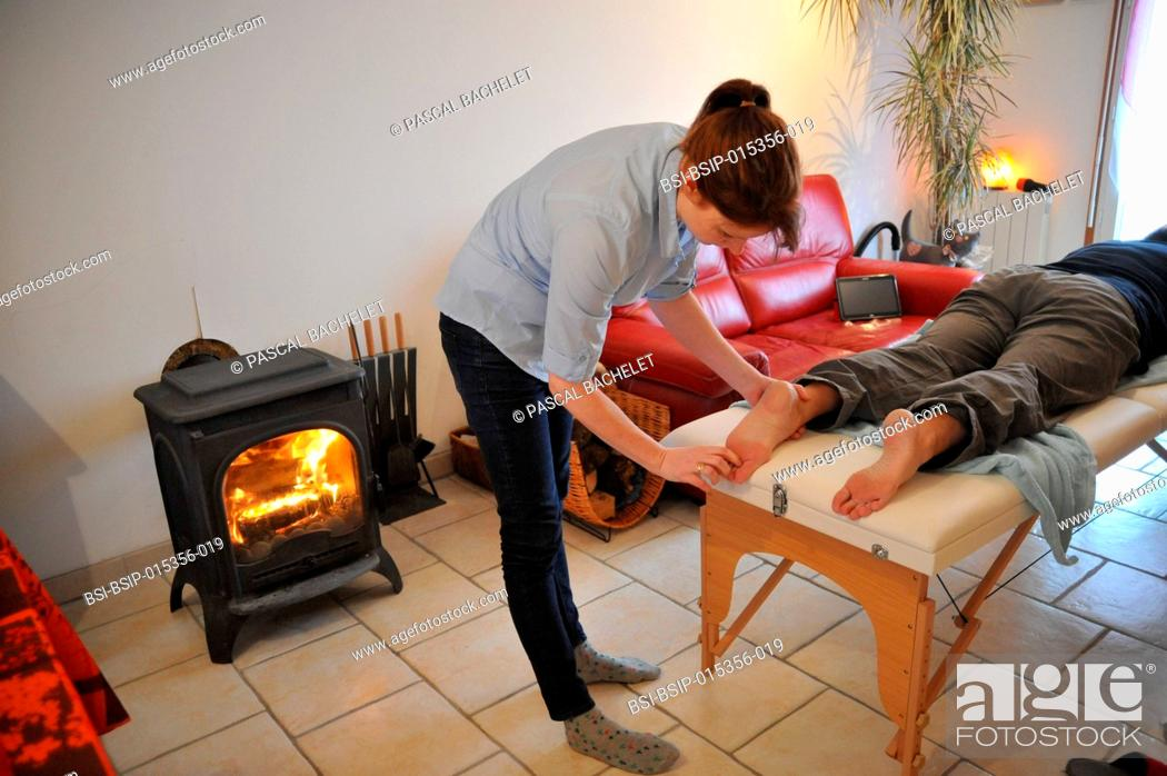 Stock Photo: Reportage on an independent nurse trained in shiatsu. She carries out sessions at home. Shiatsu is a Japanese discipline which consists of stimulating the body.