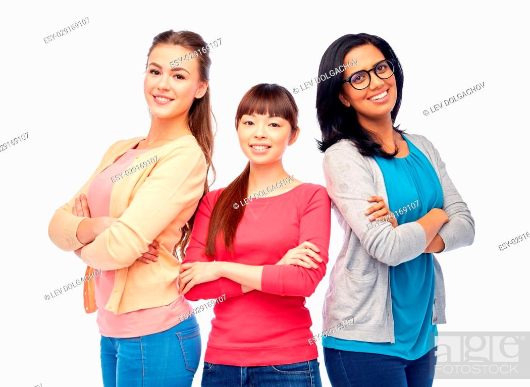 Stock Photo: diversity, race, ethnicity and people concept - international group of happy smiling different women over white.