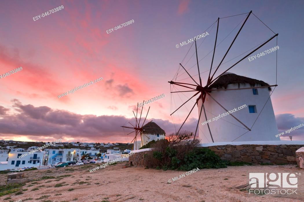 Stock Photo: Old traditional windmills over the town of Mykonos. .