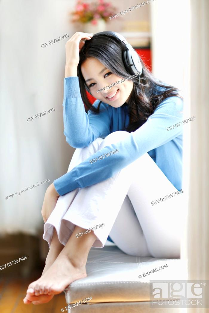 Stock Photo: Fashion young woman wearing headset, listen to music high quality photo.