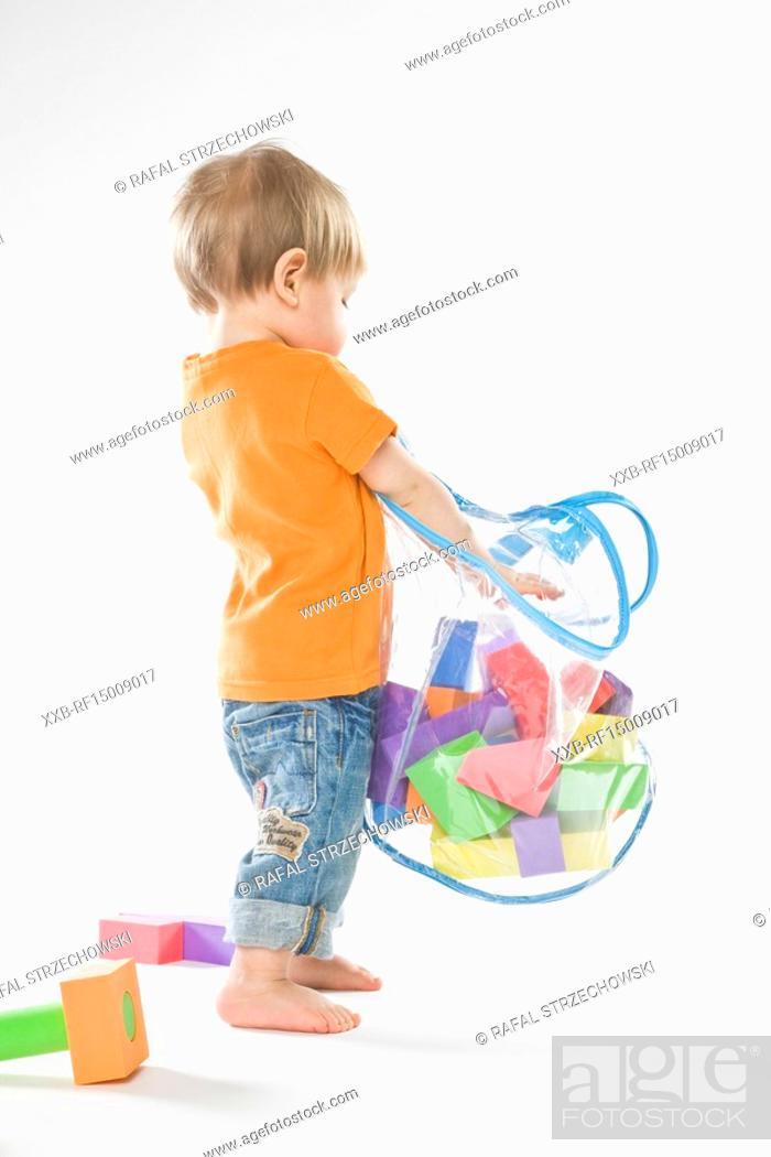 Stock Photo: baby playing with bricks.