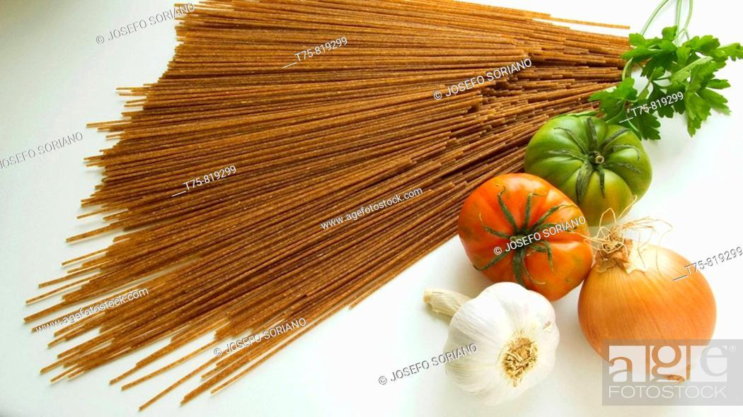 Stock Photo: spaghetti, tomatoes, onions, garlic and parsley.