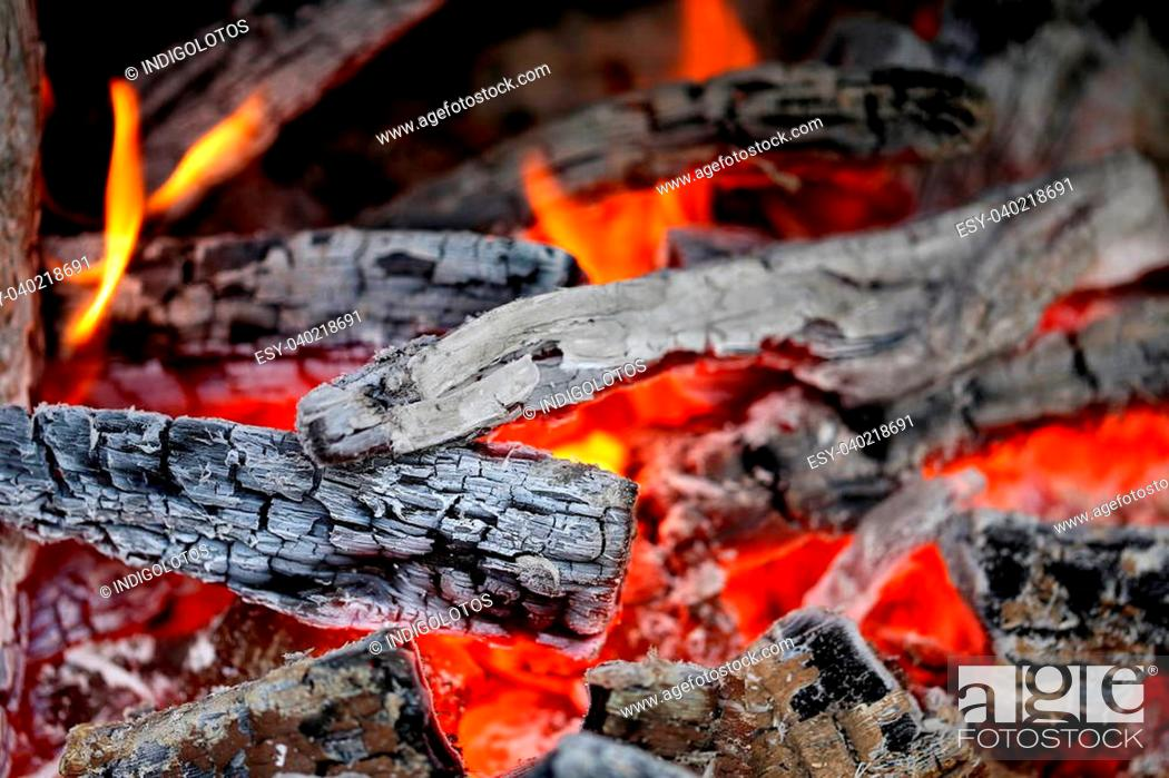 Stock Photo: Wooden embers close-up on a whole background.