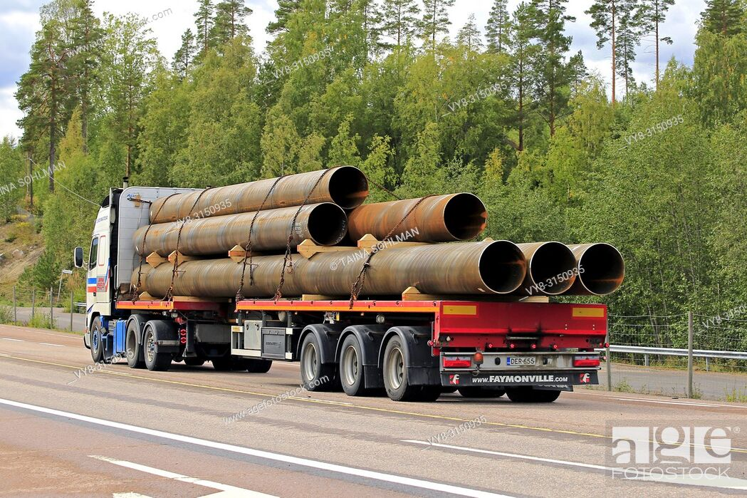 Stock Photo: Orivesi, Finland - August 27, 2018: Volvo FH12 semi trailer of Seikkala Logistics Oy transports metallic pipes along highway 4 in early autumn, rear view.