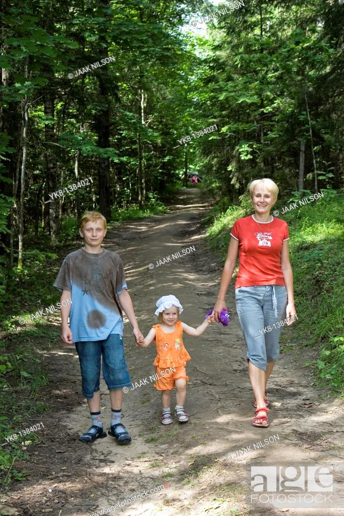 Stock Photo: Young Woman With Kids, Family Walking Hand in Hand in Forest.