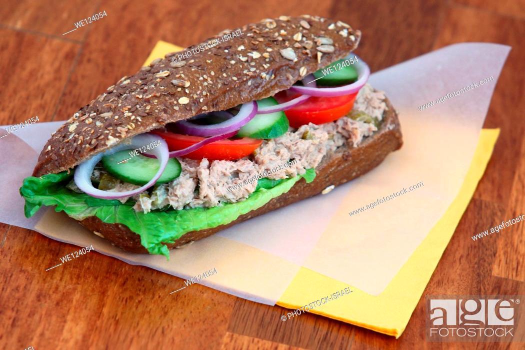 Stock Photo: Tuna salad sandwich with tomato and cucumber.