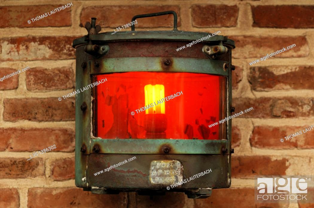 Stock Photo: Old ship lantern of 1952, with modern light bulb.