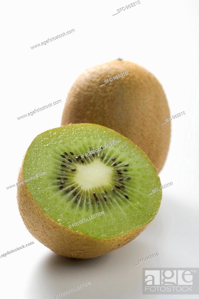 Stock Photo: Whole kiwi fruit and half a kiwi fruit.