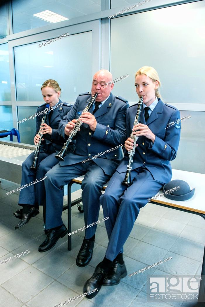 Stock Photo: Eindhoven Airbase, Eindhoven, Netherlands. Three military musicians preparing for a ceremony upon returning personnel from Afghanistan.