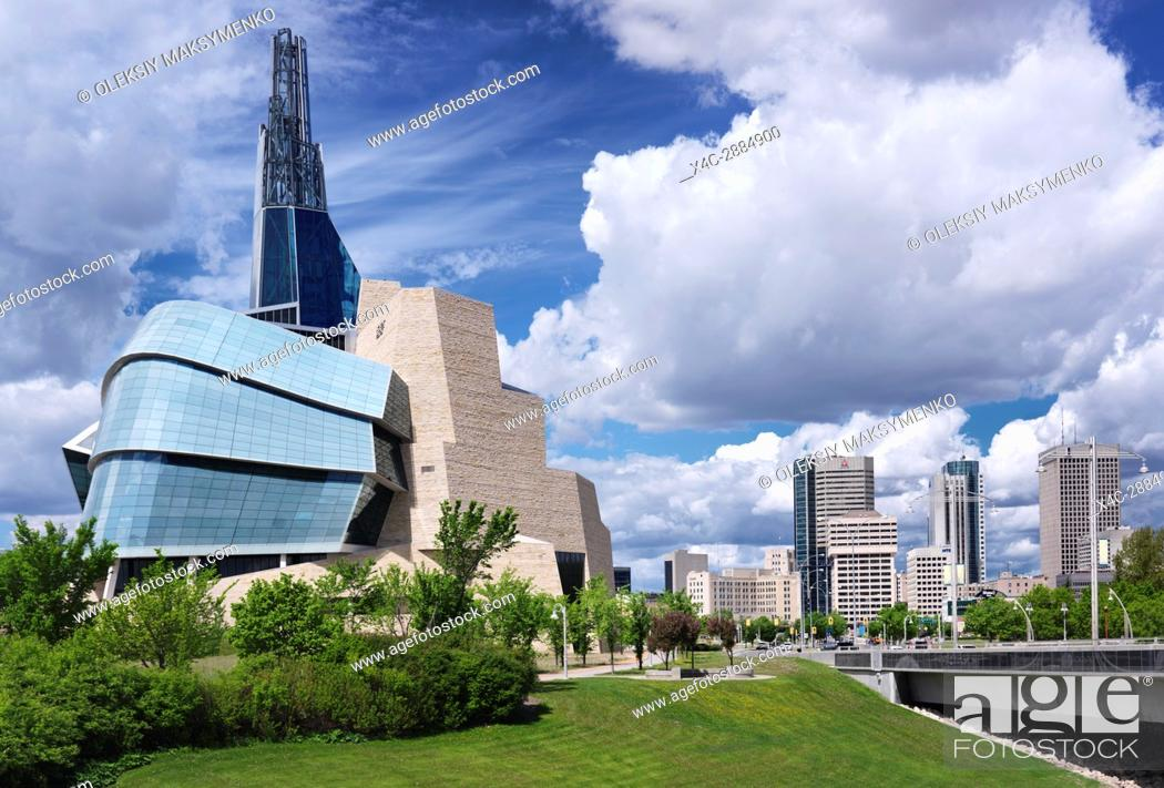 Stock Photo: Canadian Museum for Human Rights and downtown skyline under beautiful cloudy sky on a summer day in Winnipeg, Manitoba, Canada 2017.