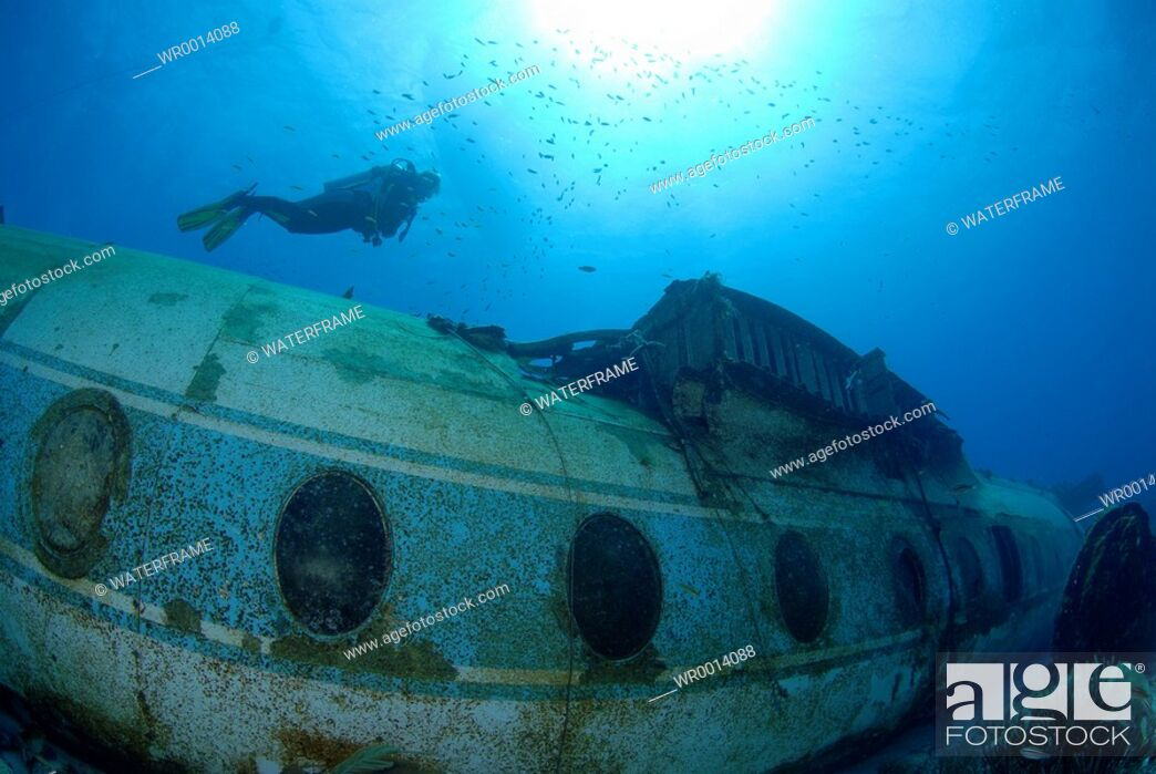 Stock Photo: Diver at Airplane Wreck, Caribbean Sea, Netherland Antilles, Curacao.