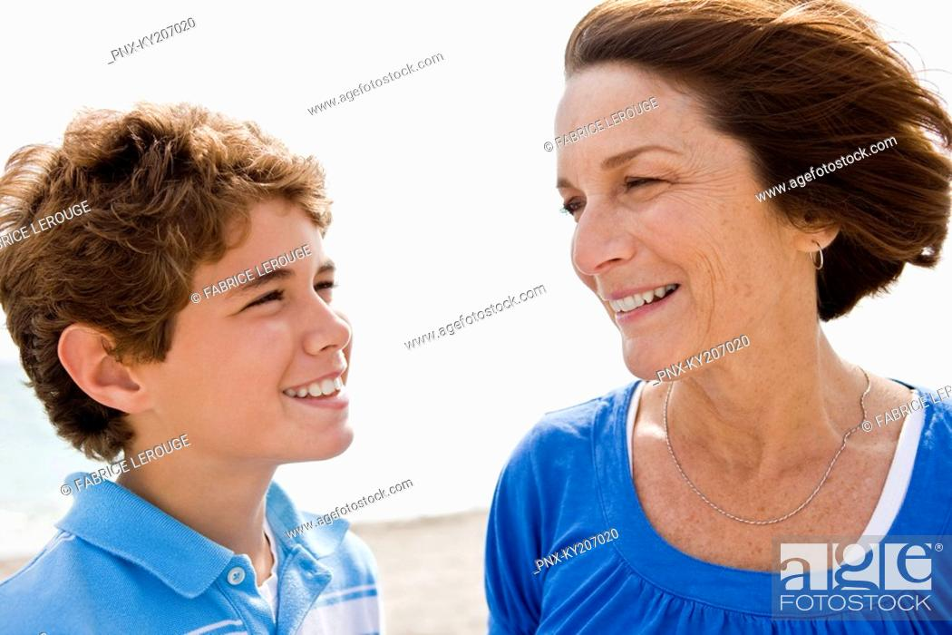 Stock Photo: Woman and her grandson looking at each other and smiling.