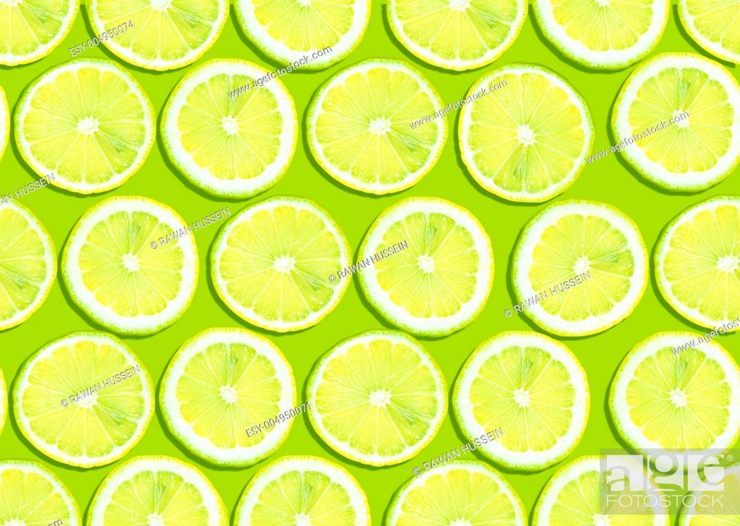 Stock Photo: seamless background of lemon slices.