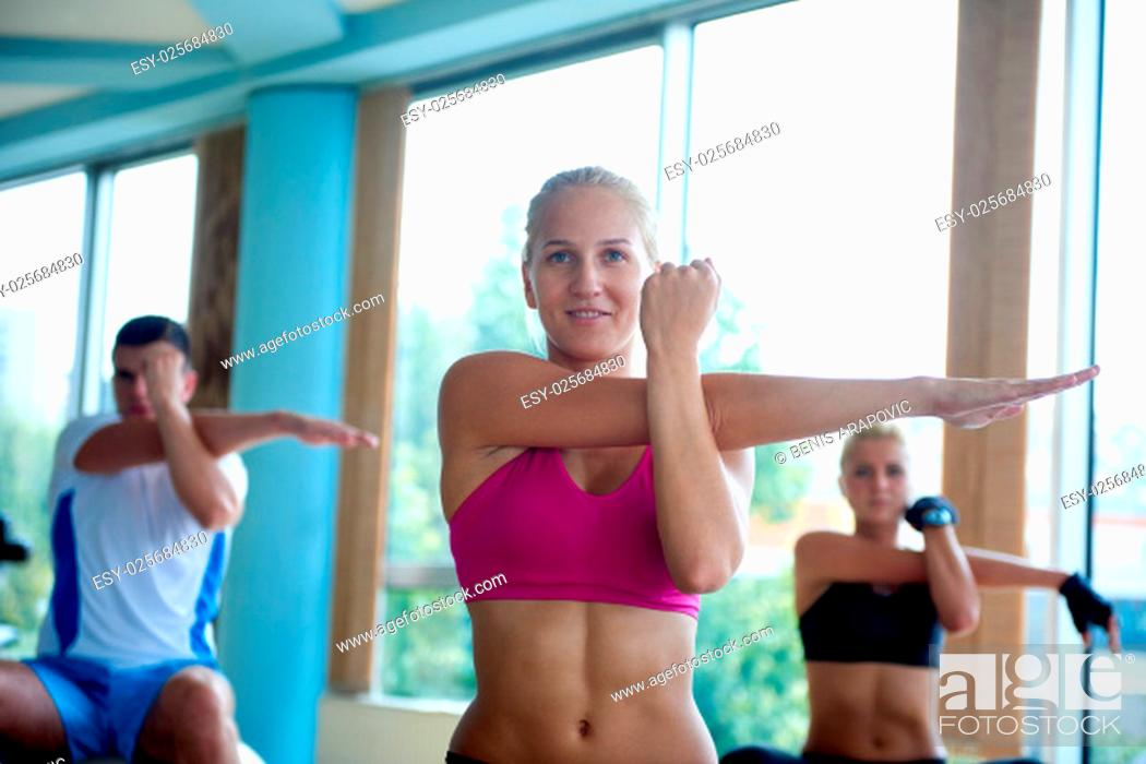 Stock Photo: group of people exercise with balls on yoga class in fitness gym.