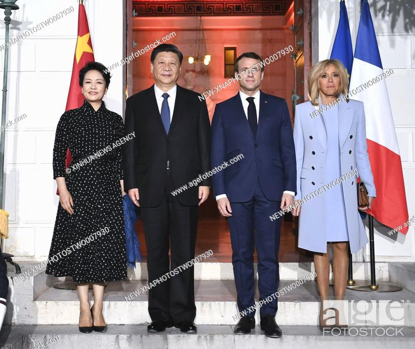 Stock Photo: (190324) -- NICE, March 24, 2019 (Xinhua) -- Chinese President Xi Jinping (2nd L) and his wife Peng Liyuan (1st L) pose for a group photo with French President.