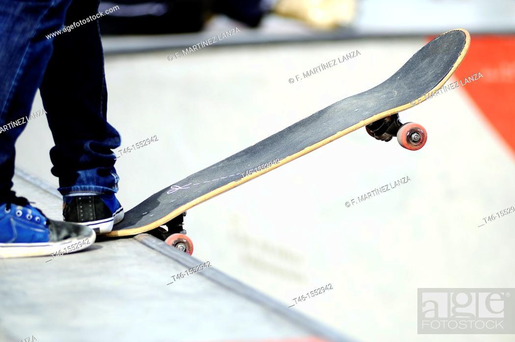 Stock Photo: Skate skater skates in a spor in Madrid.