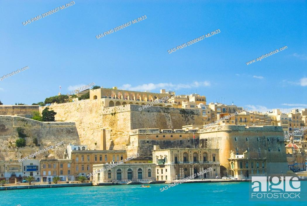 Stock Photo: Buildings at the waterfront, Grand Harbor, Valletta, Malta.