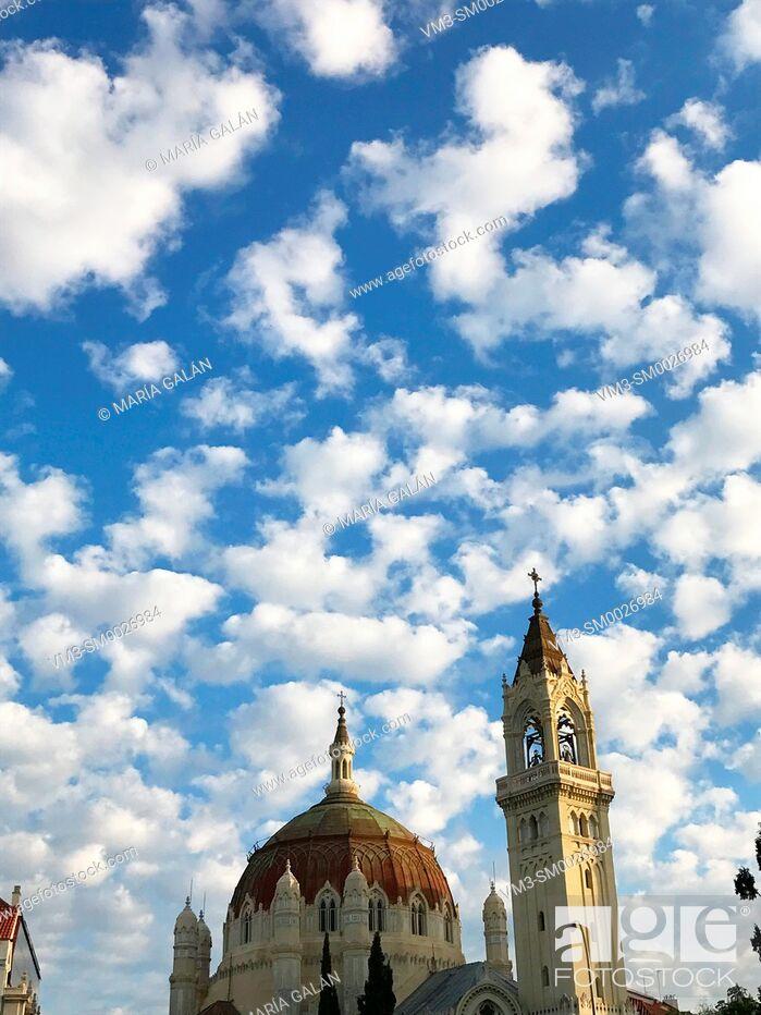 Stock Photo: San Manuel y San Benito church over cloudy sky. Madrid, Spain.