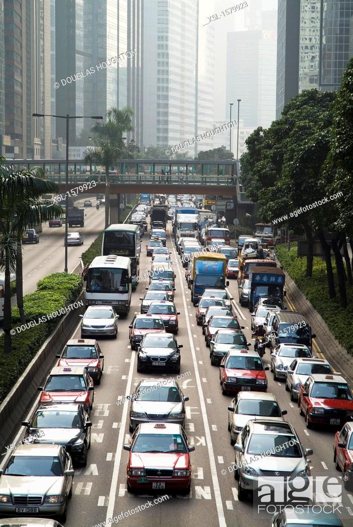 Stock Photo: WANCHAI HONG KONG Gloucester Road traffic queuing near Harbour Tunnel.