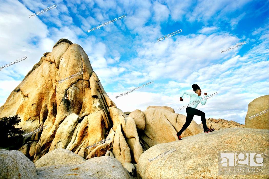 Stock Photo: Black runner in desert landscape, Joshua Tree National Park, California, United States.