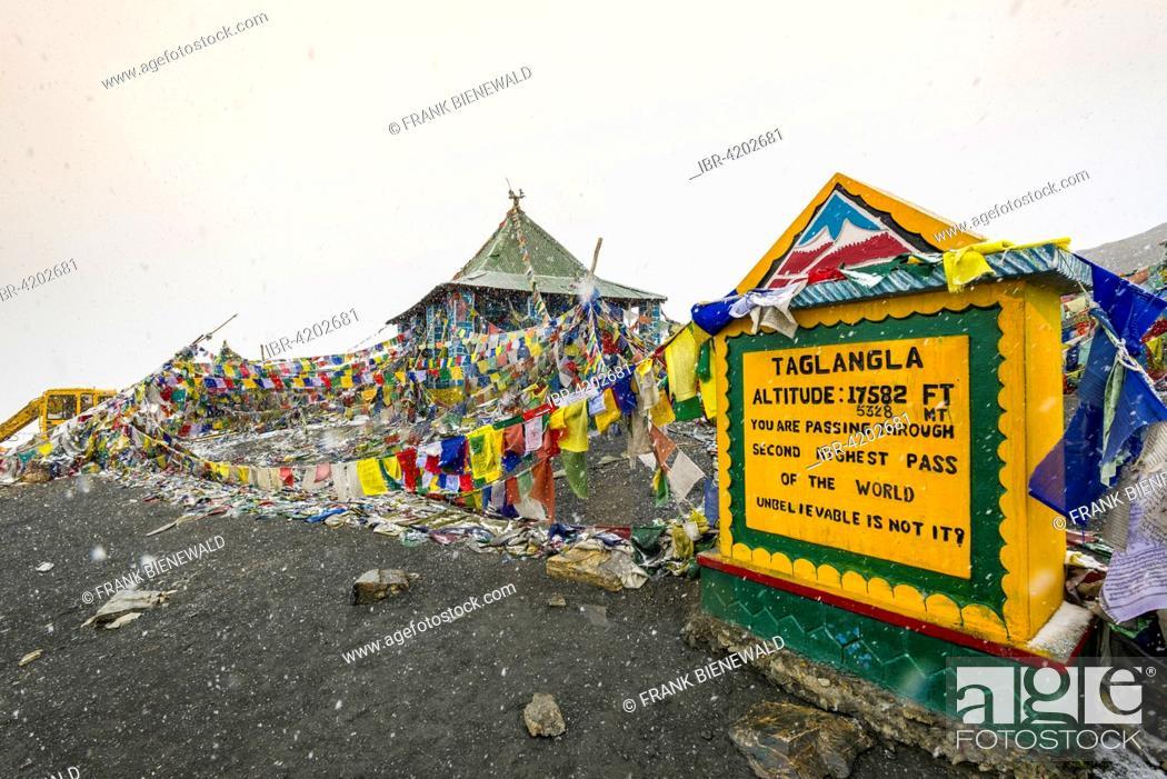 Stock Photo: The milestone on top of Taglang La, 5, 325 m, the highest pass on the Manali-Leh Highway, during snowfall, Rumtse, Jammu and Kashmir, India.