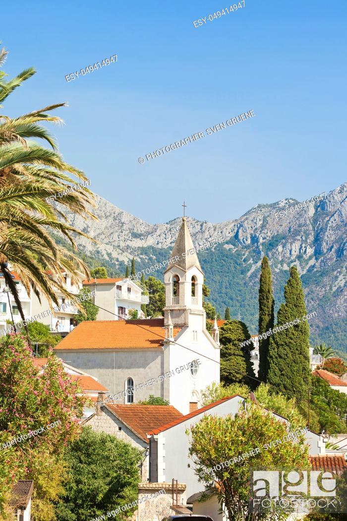 Stock Photo: Brist, Dalmatia, Croatia, Europe - Steeple of Brist in front of the mountains.