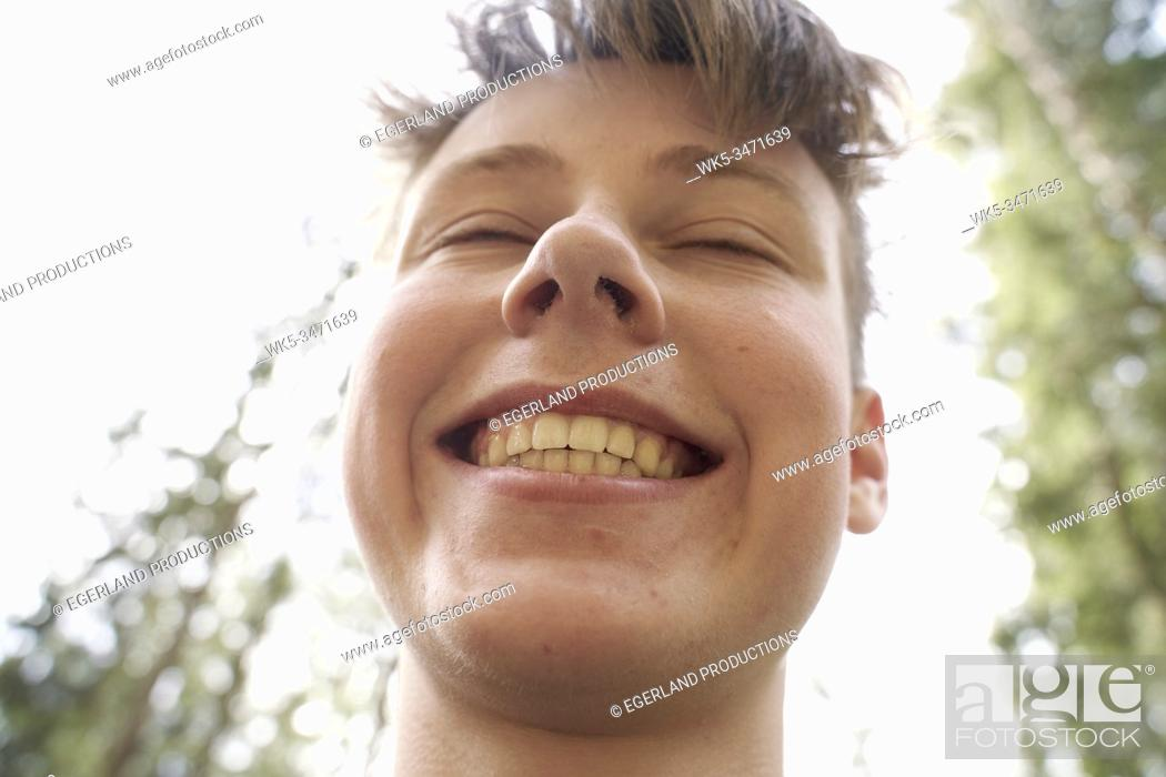 Stock Photo: Close-up portrait of young boy in forest. Bad Tölz, Upper bavaria, Germany.