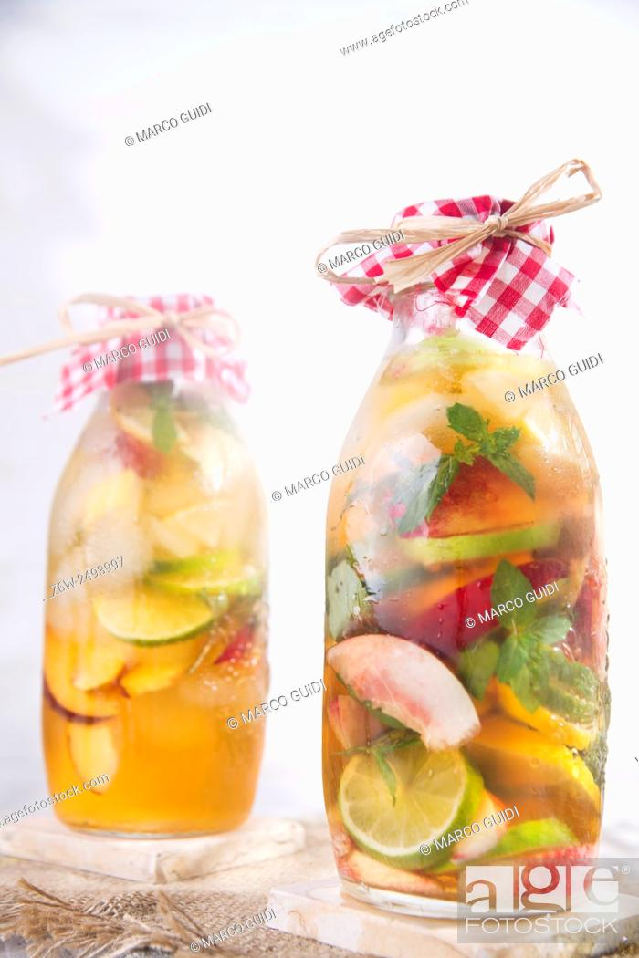 Stock Photo: bottle of infused fruit tea with peach and lemon.