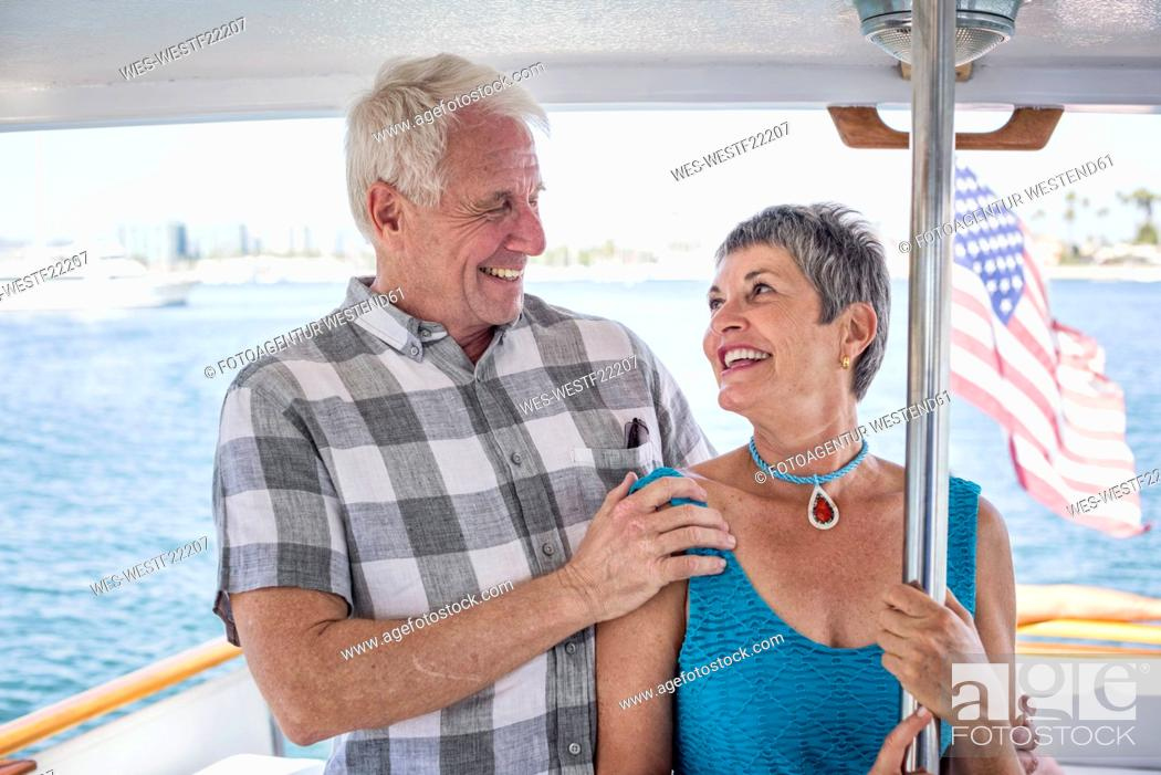 Stock Photo: Smiling couple on a boat trip.