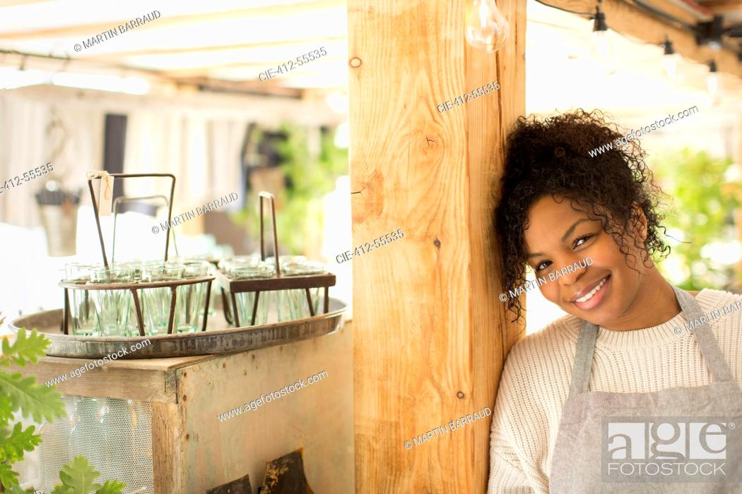 Stock Photo: Portrait happy confident female plant nursery owner.
